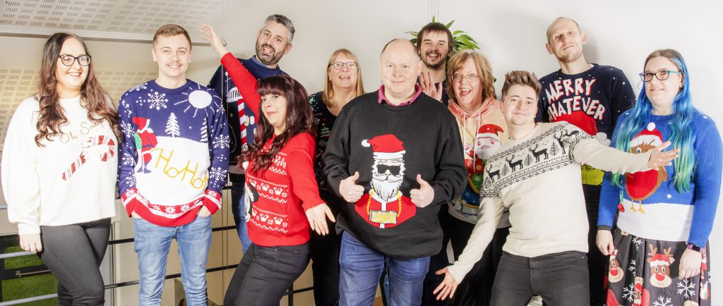 Staff christmas photo. Christmas & New year opening hours